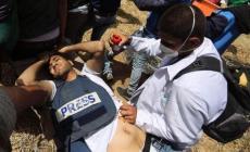 لحظة اصابة الصحفي الشهيد ياسر مرتجى