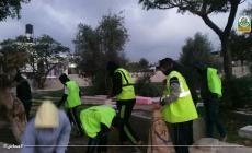 جانب من تنظيف المقابر في ذكرى انطلاقة حماس