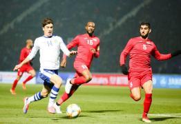 جانب من مباراة فلسطين وأوزبكستان