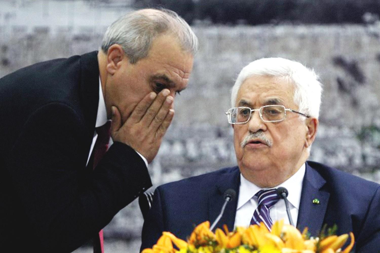 رئيس السلطة محمود عباس ومسؤول مخابراته