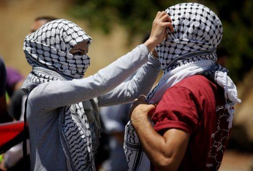 الرسالة نت - المرأة والشعب المسلح